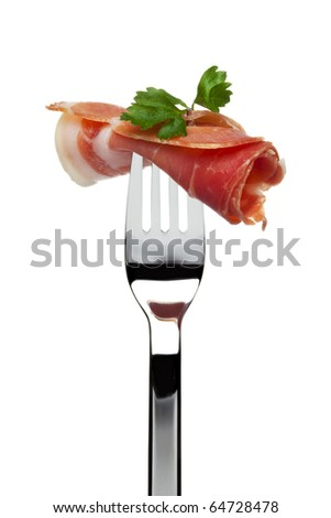 roll of dry-cured spanish serrano ham sticking on fork, garnished with parsley, isolated on white