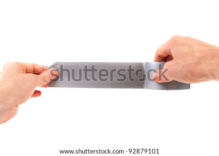 roll of duct tape in hands on white background