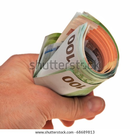 Roll of Euro banknotes hold by white male hand.