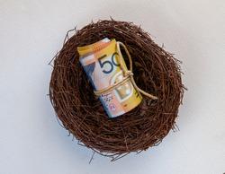 Roll of fifty Australian dollars in a nest.