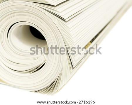 Roll of magazines isolated on a white background. Shallow DOF