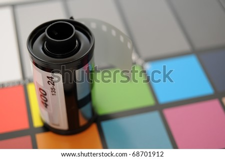 Roll of 35mm Film on top of color calibrated card of squares.