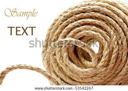 Roll of sisal rope on white background with copy space.  Macro with shallow dof.