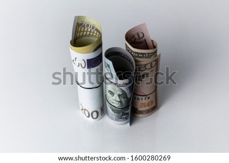 Roll of usd and euro banknotes isolated against white background