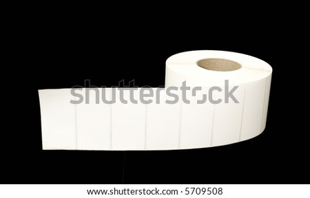 Roll of white labels on black background