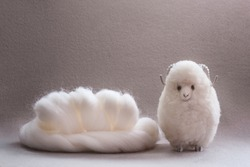 Roll of white wool for handcraft, merino wool, handmade toy made of wool. Suitable for knitting, wool felting.