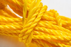 Roll of yellow nylon rope, close up