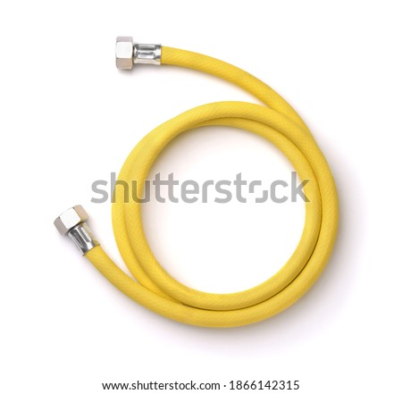 Roll of yellow reinforced propane gas hose isolated on white Stock foto ©