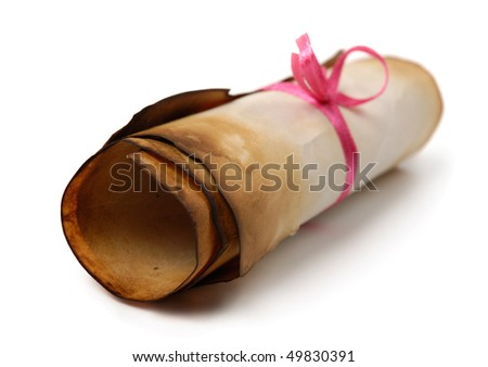 Roll of yellowish burnt vintage parchment tied with a red ribbon Isolated on white background