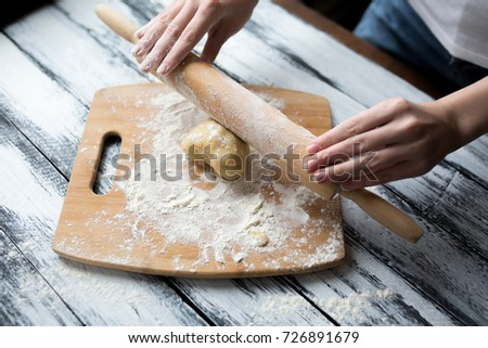 Roll out pastry dough - Shutterstock ID 726891679