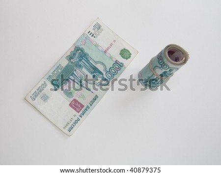 Roll rubles on light background with 1000 bank note