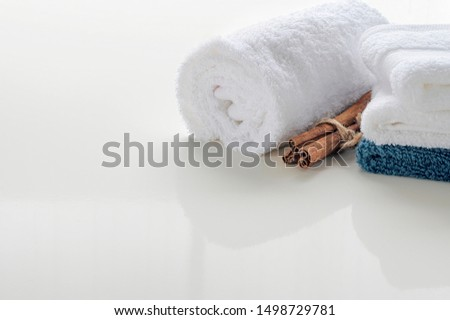 Roll up of white towels on white table with copy space. Copy space for product display montage. #1498729781
