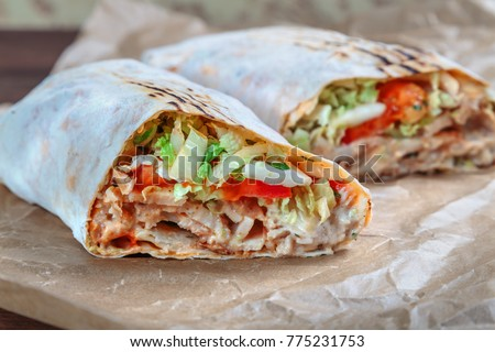 Roll with chicken and vegetables. Shawarma. Fast food.