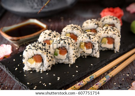 Roll with salmon, avocado, cucumber. Sushi menu. Japanese food.