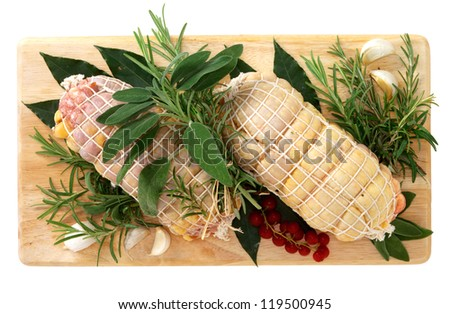 Rolled chicken on wooden board