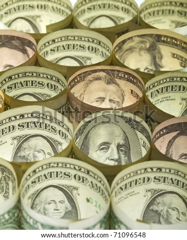 Rolled dollar banknotes money background - presidents peeking at the camera