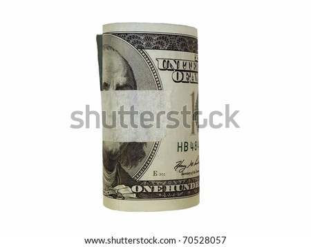 Rolled $100 dollar bills and adhesive tape isolated on white background