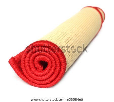 Rolled door mat over white background