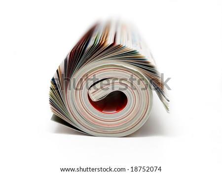 rolled magazine isolated on white