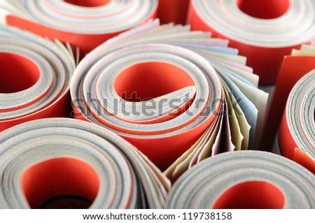 Rolled magazines background