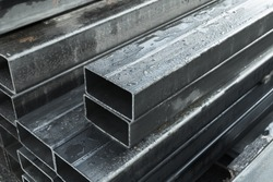 Rolled metal products, steel pipes with rectangular cross-section, close-up photo