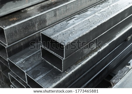 Photo of  Rolled metal products, steel pipes with rectangular cross-section, close-up photo