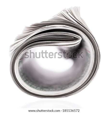 Rolled newspaper isolated on white background
