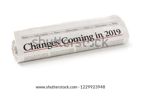 Rolled newspaper with the headline Changes coming in 2019 #1229923948
