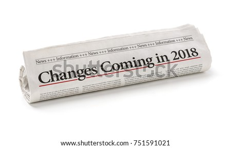 Rolled newspaper with the headline Changes coming in 2018 #751591021