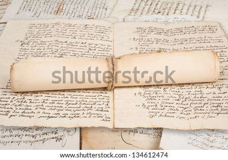 Rolled parchment on old manuscript