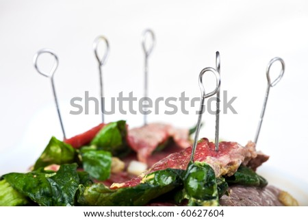 rolled raw veal cutlets and assorted ingredients