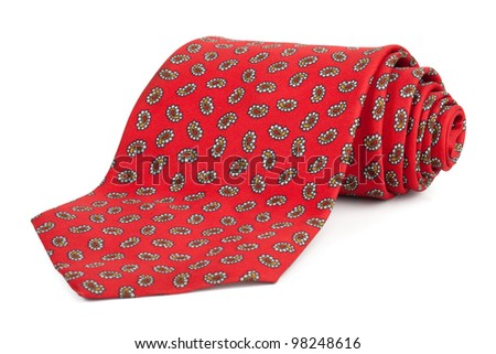 Rolled red tie on a white background