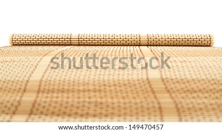 Rolled straw mat background with a shallow depth of field