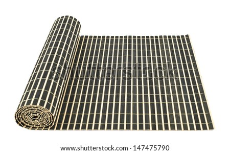 Rolled straw mat isolated over white background