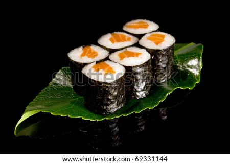 rolled sushi on leaf