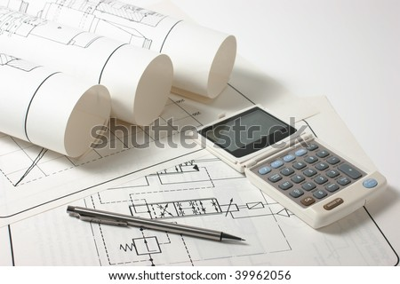 rolled technical drawings and a calculator
