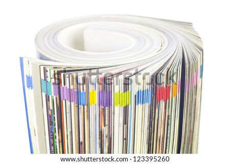 Rolled up magazine, newspaper, with colorful index, white background