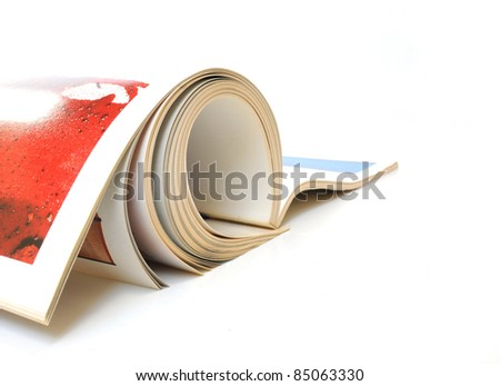 Rolled up magazine over white background
