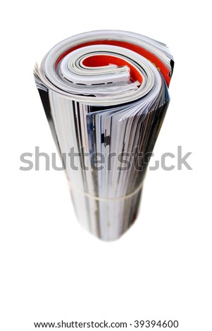 Rolled up magazines isolated over white. Shallow depth of field. - stock photo