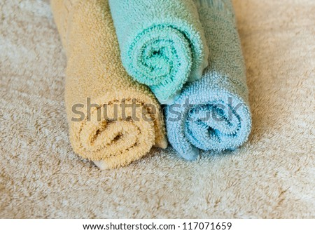Rolled up multi color soft and fresh spa towels.Wellness objects.