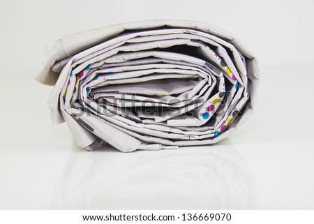 rolled up newspaper in closeup