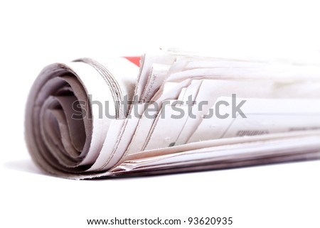 Rolled up newspaper isolated on white background.