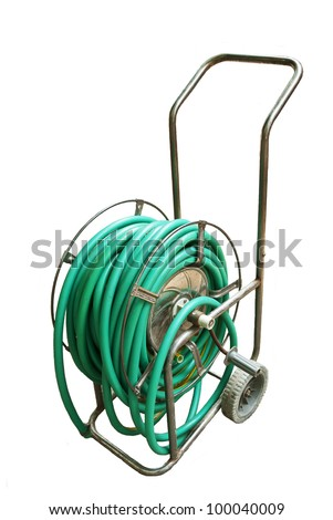 rolled   green pvc garden hose stock photo