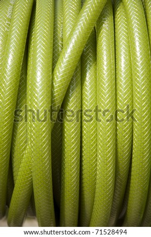 rolled up of green PVC  garden hose.