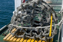 Rolled up ship's emergency rope ladder.