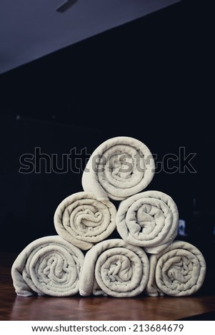 rolled up white beach towel