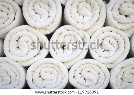 Rolled up white spa towels