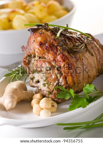 rolled veal stuffed with nuts, ginger and parsley