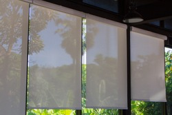 Roller Blinds at the glass window, white Micro Sunscreen.