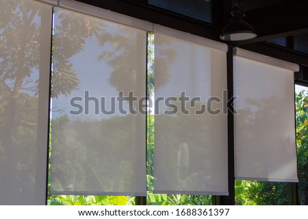 Roller Blinds at the glass window, white Micro Sunscreen. Foto stock ©